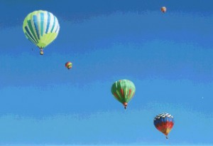 A line of balloons at dawn