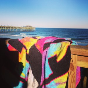 Beach Life - colorful towels drying on the porch